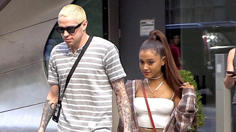 Ariana Grande Hold Hands With Pete Davidson While Wearing His Dad's Badge on Her Neck