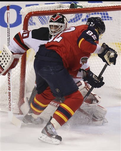 New Jersey Devils' goalie Martin Brodeur (30) blocks a shot on goal by Florida Panthers' Tomas Kepecky (82) during the first period of Game 5 in a first-round NHL Stanley Cup playoff hockey series in Sunrise, Fla., Saturday, April 21, 2012. (AP Photo/J Pat Carter)