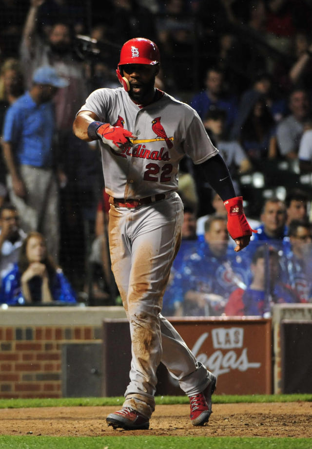 St. Louis Cardinals' Jason Heyward (22) reacts after scoring against the Chicago Cubs during the seventh inning of a baseball game, Monday, July 6, 2015, in Chicago. (AP Photo/David Banks)