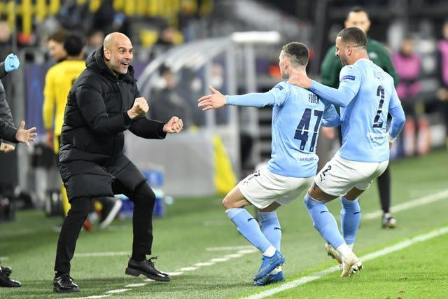 Pep Guardiola celebrates with Phil Foden after his Champions League goal against Borussia Dortmund