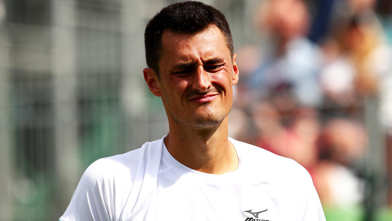 Bernard Tomic of Australia reacts in his Men's Singles first round match against Jo-Wilfred Tsonga of France during Day two of The Championships - Wimbledon 2019 at All England Lawn Tennis and Croquet Club on July 02, 2019 in London, England. (Photo by Clive Brunskill/Getty Images)