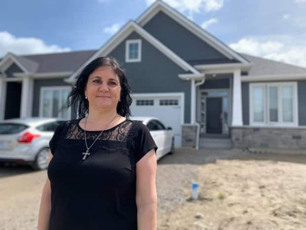 Cristina Conciatori of Windsor, Ont., says she's stuck renting despite being approved to purchase a home worth hundreds of thousands of dollars, because bidding wars are making homeownership unaffordable. (Katerina Georgieva/CBC - image credit)