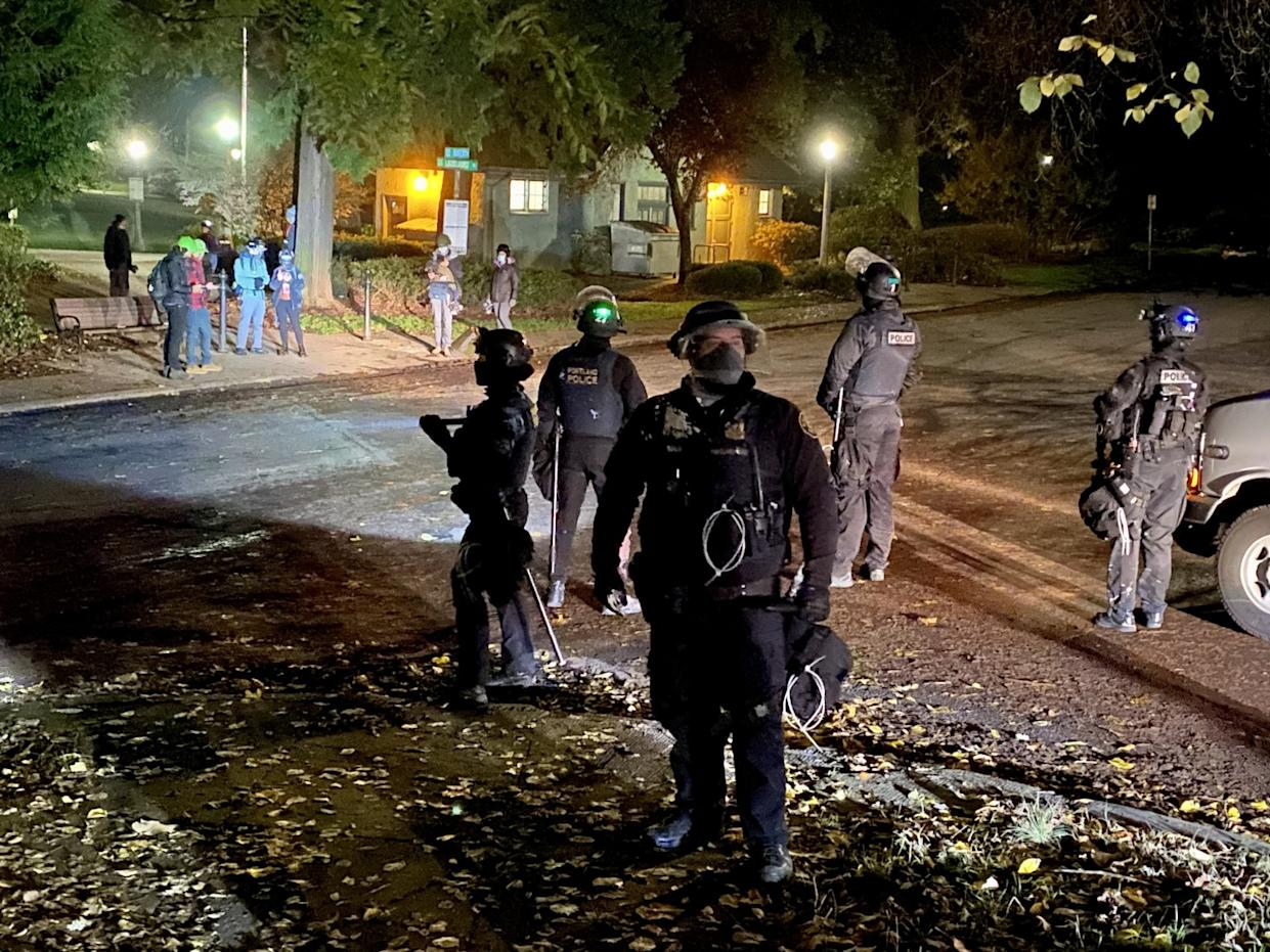 Portland police look for anarchists who slipped away after smashing windows at the county Democratic Party headquarters.