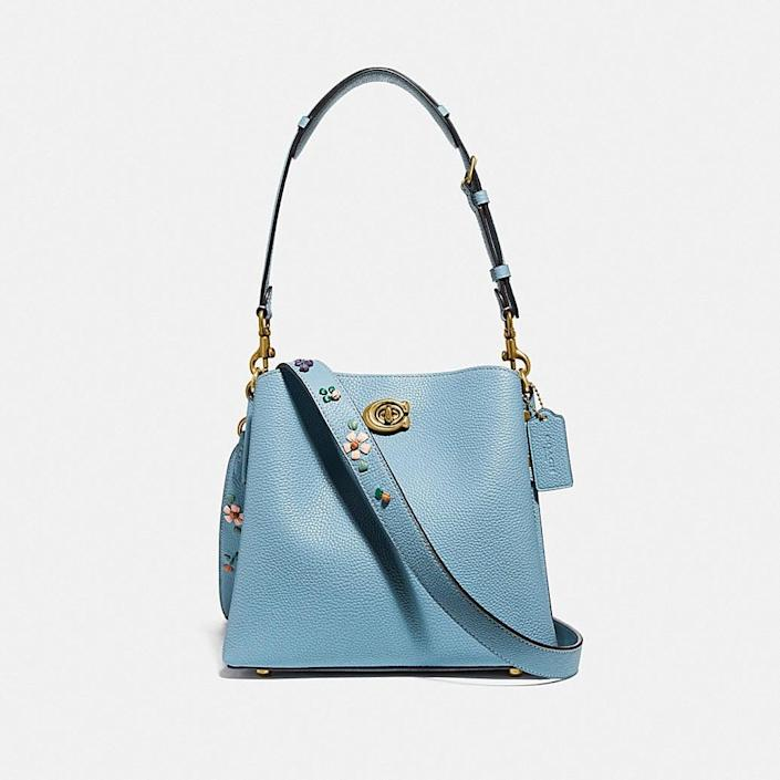 <p>This adorable <span>Coach Willow Bucket Bag With Floral Embroidery</span> ($350) is so convenient because it comes with a useful crossbody strap, too.</p>