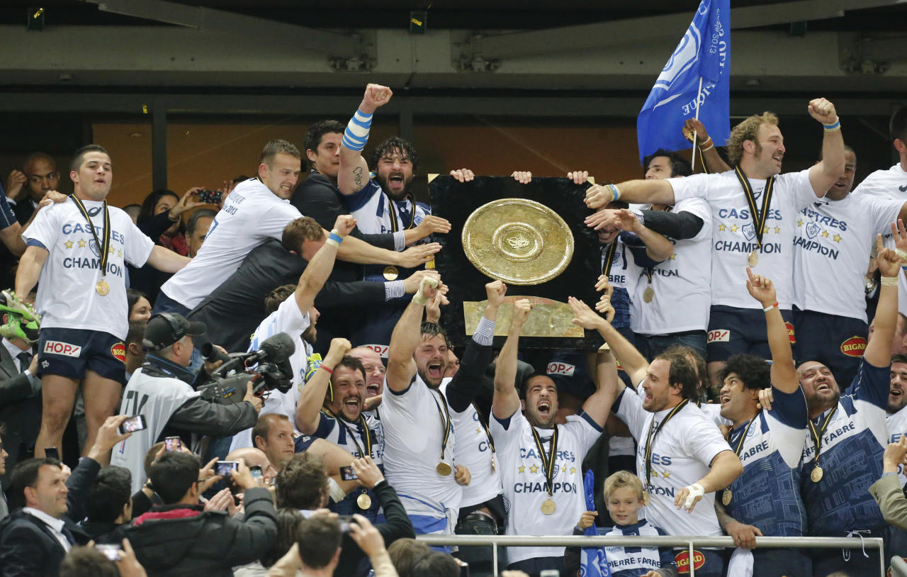 Castres Olympic rugby team holding the Bouclier de Brennus Trophy celebrate their victory over Toulon during their Top 14 final rugby match at Stade de France stadium in Saint Denis, north of Paris, France, Saturday, June 1, 2013. (AP Photo/Jacques Brinon)