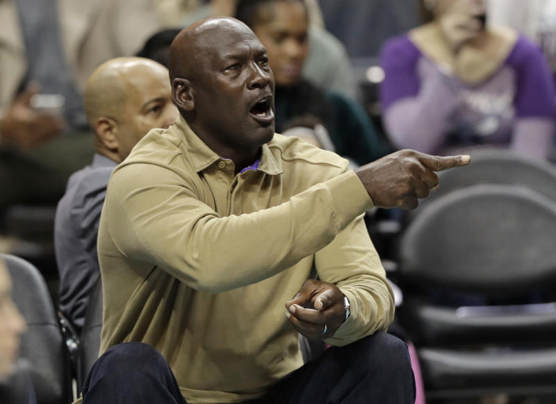 Charlotte Hornets owner Michael Jordan shouts to his team during the first half of an NBA basketball game against the Utah Jazz in Charlotte, N.C., Friday, Jan. 12, 2018. (AP Photo/Chuck Burton)