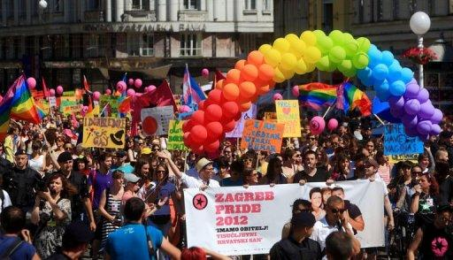 Participants display banners as they march during a Gay Pride parade in Zagreb. Some 2,000 people took part in a gay-rights march on Croatia's capital, calling on the government to boost the rights of same-sex couples in the largely conservative EU-bound country