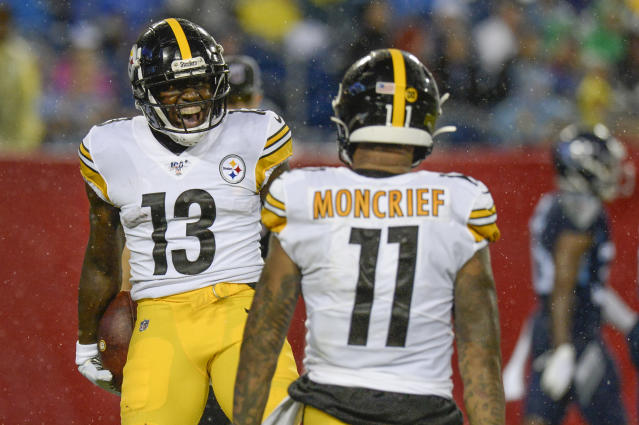 Pittsburgh Steelers wide receiver James Washington (13) celebrates with Donte Moncrief (11) after Washington scored a touchdown on a 41-yard pass play against the Tennessee Titans in the first half of a preseason NFL football game Sunday, Aug. 25, 2019, in Nashville, Tenn. (AP Photo/Mark Zaleski)