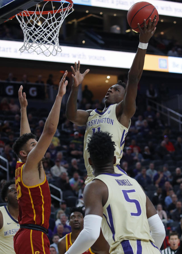 Washington's Nahziah Carter shoots over Southern California's Bennie Boatwright during the first half of an NCAA college basketball game in the quarterfinal round of the Pac-12 men's tournament Thursday, March 14, 2019, in Las Vegas. (AP Photo/John Locher)
