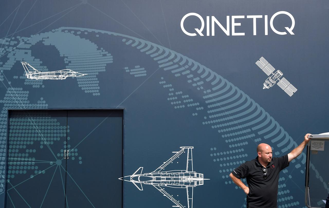 A man stands next to a pavilion for defence technology company Qinetic at Farnborough International Airshow in Farnborough, Britain, July 17, 2018. REUTERS/Toby Melville