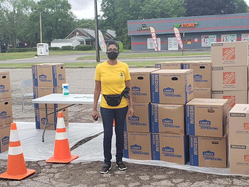Lisa Williams, 55, is warning people that Cash App does not have a live customer service phone line. But scammers are listing a number online and were able to drain her community development group's fundraiser of $335 when she sought technical help. She is pictured standing in front of the boxes of groceries that were given to 100 families on June 27, 2020. She is wearing a 2020 Census t-shirt because the group also did drive-thru census as it gave out groceries.