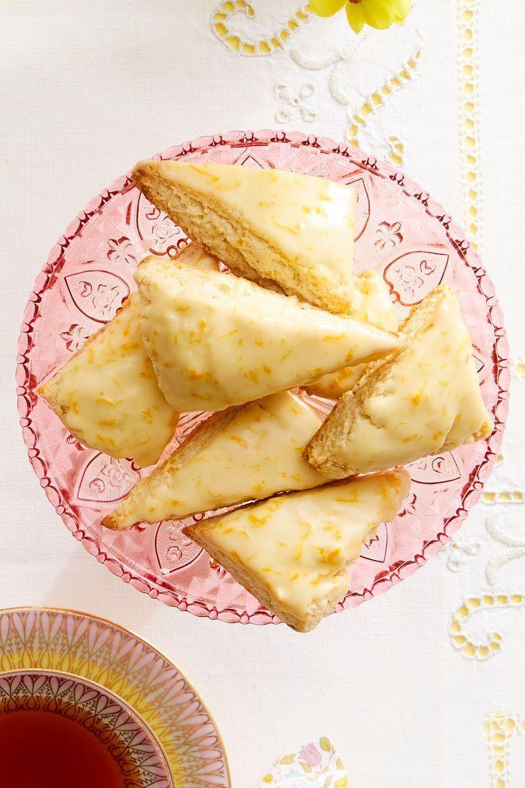 """<p>Treat Mom to tea time in bed! These citrusy glazed scones would pair perfectly with a cup of English Breakfast or Earl Grey. </p><p><a href=""""https://www.thepioneerwoman.com/food-cooking/recipes/a35538011/petite-orange-vanilla-scones-recipe/"""" rel=""""nofollow noopener"""" target=""""_blank"""" data-ylk=""""slk:Get the recipe."""" class=""""link rapid-noclick-resp""""><strong>Get the recipe.</strong></a></p><p><a class=""""link rapid-noclick-resp"""" href=""""https://go.redirectingat.com?id=74968X1596630&url=https%3A%2F%2Fwww.walmart.com%2Fbrowse%2Fhome%2Fdrinkware%2Fthe-pioneer-woman%2F4044_623679_639999_3148543&sref=https%3A%2F%2Fwww.thepioneerwoman.com%2Ffood-cooking%2Frecipes%2Fg36145857%2Fbreakfast-in-bed-recipes%2F"""" rel=""""nofollow noopener"""" target=""""_blank"""" data-ylk=""""slk:SHOP TEAPOTS"""">SHOP TEAPOTS</a></p>"""