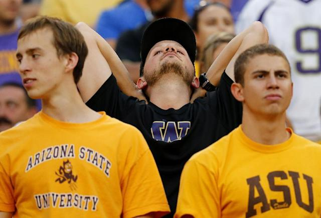 A Washington fan looks away during the second half of an NCAA college football game against Arizona State, Saturday, Oct. 19, 2013, in Tempe, Ariz. Arizona State won 53-24. (AP Photo/Matt York)