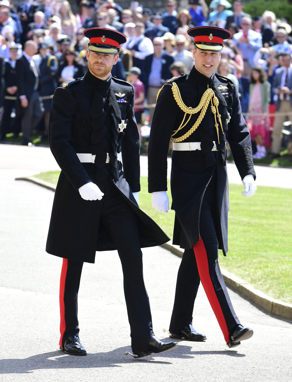 Britain's Prince Harry, left and his brother Prince William, the Duke of Cambridge arrive for the wedding ceremony of Prince Harry and Meghan Markle at St. George's Chapel in Windsor Castle in Windsor, near London, England, Saturday, May 19, 2018. (Ian West/pool photo via AP)