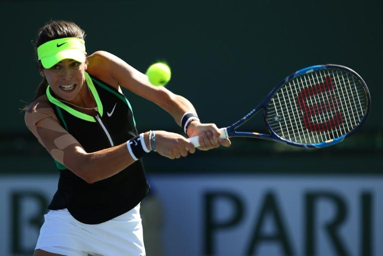 Ajla Tomljanovic of Croatia plays a backhand against Julia Goerges of Germany in their first round match during day four of the BNP Paribas Open at Indian Wells Tennis Garden on March 9, 2017
