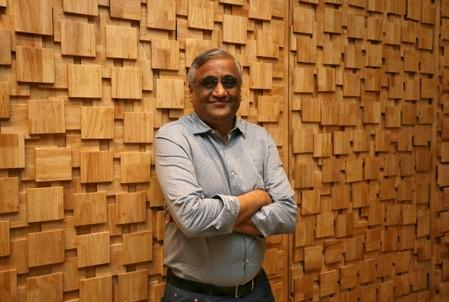 FILE PHOTO: Kishore Biyani, CEO and founder of India's Future Group poses after the inauguration of Foodhall, a premium lifestyle food superstore by the Future Group, store in Mumbai