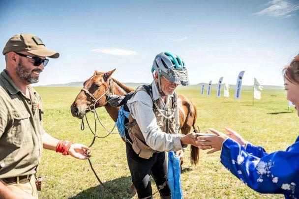 PHOTO: Robert Long, known by the nickname Cowboy Bob, who is the oldest winner of Mongol Derby, the 1,000 km world's longest horse race, is pictured with his horse near Jargalt, Mongolia, Aug. 14, 2019. (The Adventurists/Mongol Derby/Sarah Farnsworth via Reuters)
