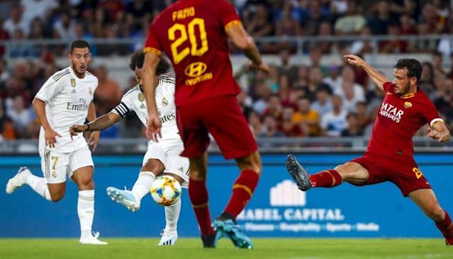 Real Madrid's Marcelo (C) scores the 0-1 goal during the international friendly soccer match AS Roma vs Real Madrid CF at Olimpico stadium in Rome, Italy, 11 August 2019. (Futbol, Amistoso, Italia, Roma) EFE/EPA/ANGELO CARCONI