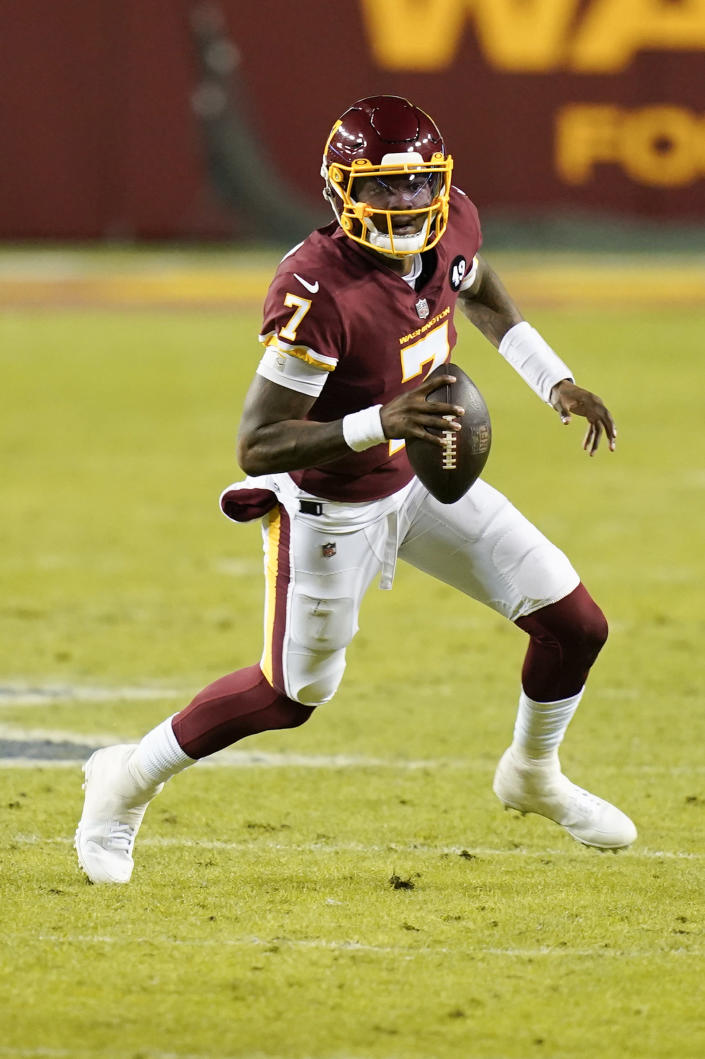 Washington Football Team quarterback Dwayne Haskins (7) runs with the ball during the first half of an NFL football game against the Carolina Panthers, Sunday, Dec. 27, 2020, in Landover, Md. (AP Photo/Carolyn Kaster)