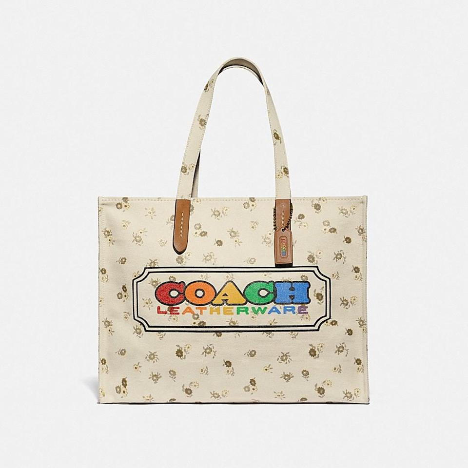 """<p><a href=""""https://www.popsugar.com/buy/Coach-Tote-Rainbow-Coach-Badge-583559?p_name=Coach%20Tote%20With%20Rainbow%20Coach%20Badge&retailer=coach.com&pid=583559&price=195&evar1=fab%3Aus&evar9=47563823&evar98=https%3A%2F%2Fwww.popsugar.com%2Ffashion%2Fphoto-gallery%2F47563823%2Fimage%2F47563874%2FCoach-Tote-With-Rainbow-Coach-Badge&list1=coach%2Cpride%20month%2Clgbtq%2B&prop13=api&pdata=1"""" class=""""link rapid-noclick-resp"""" rel=""""nofollow noopener"""" target=""""_blank"""" data-ylk=""""slk:Coach Tote With Rainbow Coach Badge"""">Coach Tote With Rainbow Coach Badge</a> ($195)</p>"""