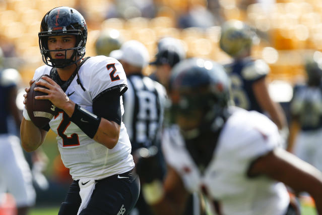 "Oklahoma State quarterback <a class=""link rapid-noclick-resp"" href=""/ncaaf/players/239330/"" data-ylk=""slk:Mason Rudolph"">Mason Rudolph</a> (2) during warmups before an NCAA football game against Pittsburgh, Saturday, Sept. 16, 2017, in Pittsburgh. (AP Photo/Keith Srakocic)"