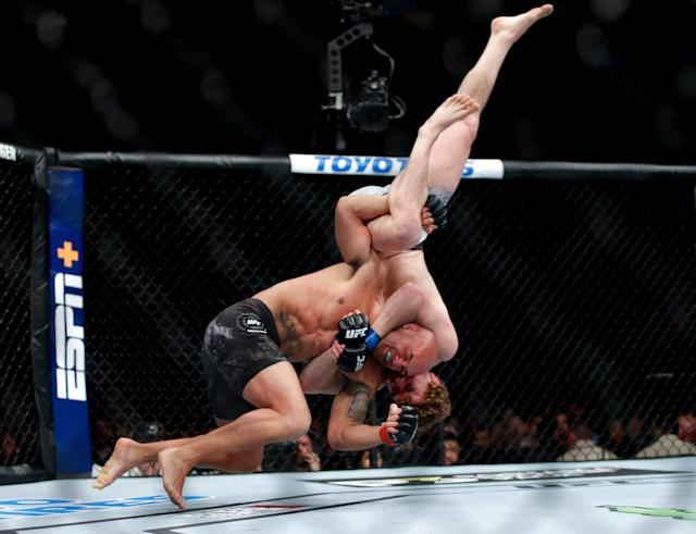 Robbie Lawler spiking Ben Askren on his neck and head in March 2019, at UFC 235. (AP)