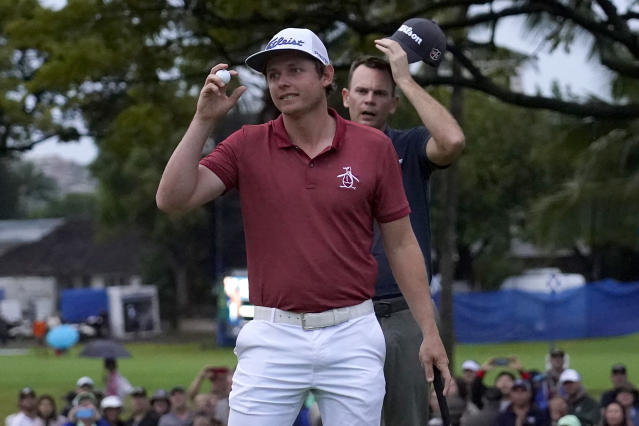 Cameron Smith celebrates his win on the 10th green after the final round of the Sony Open PGA Tour golf event, Sunday, Jan. 12, 2020, at Waialae Country Club in Honolulu. Smith defeated Brendan Steele, rear, in a one-hole playoff. (AP Photo/Matt York)