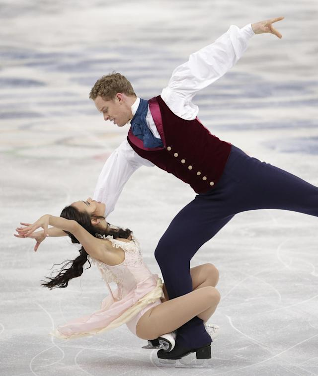 Madison Chock and Evan Bates of the United States compete in the ice dance free dance figure skating finals at the Iceberg Skating Palace during the 2014 Winter Olympics, Monday, Feb. 17, 2014, in Sochi, Russia. (AP Photo/Bernat Armangue)