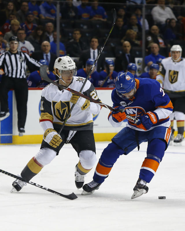 Vegas Golden Knights center Cody Eakin (21) and New York Islanders right wing Jordan Eberle (7) battle for the puck during the first period of an NHL hockey game, Wednesday, Dec.12, 2018, in New York. (AP Photo/Noah K. Murray)