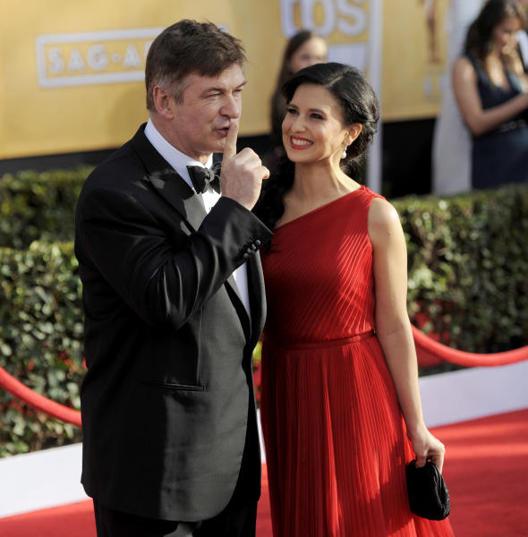 Alec Baldwin, left, and Hilaria Thomas arrive at the 19th Annual Screen Actors Guild Awards at the Shrine Auditorium in Los Angeles on Sunday, Jan. 27, 2013. (Photo by Chris Pizzello/Invision/AP)