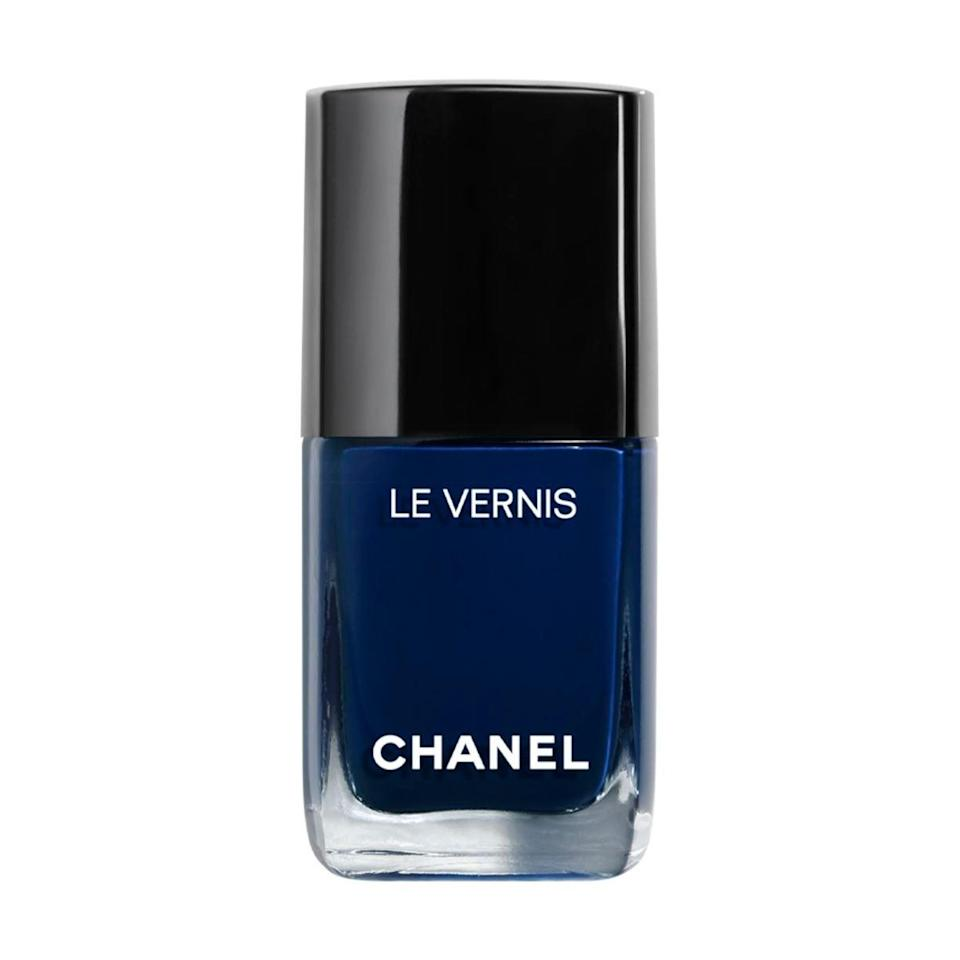 """<h3>Chanel Rhythm </h3><br>Take your dark midnight blue with a high-gloss finish.<br><br><strong>Chanel</strong> LE VERNIS Longwear Nail Colour, $, available at <a href=""""https://go.skimresources.com/?id=30283X879131&url=https%3A%2F%2Fwww.chanel.com%2Fus%2Fmakeup%2Fp%2F159763%2Fle-vernis-longwear-nail-colour%2F"""" rel=""""nofollow noopener"""" target=""""_blank"""" data-ylk=""""slk:Chanel"""" class=""""link rapid-noclick-resp"""">Chanel</a>"""
