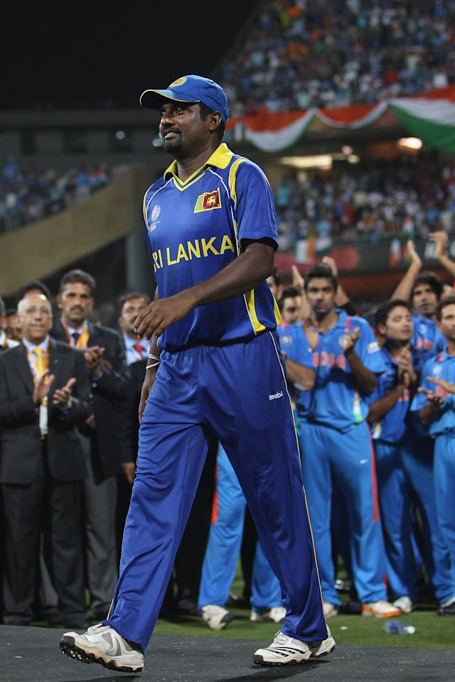 MUMBAI, INDIA - APRIL 02: Muttiah Muralitharan of Sri Lanka is applauded by the India players onto the presentation podium after his sides six wicket defeat during the 2011 ICC World Cup Final between India and Sri Lanka at Wankhede Stadium on April 2, 2011 in Mumbai, India.  (Photo by Michael Steele/Getty Images)