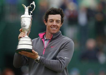 Rory McIlroy of Northern Ireland celebrates as he holds the Claret Jug after winning the British Open Championship at the Royal Liverpool Golf Club in Hoylake
