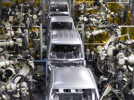 Robots assemble the main body of one of Daihatsu Motor's vehicles at the minivehicle maker's Kyushu Oita (Nakatsu) No.2 Plant in Nakatsu