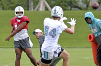 Miami Dolphins quarterback Tua Tagovailoa (1) throws a pass to Dolphins tight end Hunter Long (84) during practice at Baptist Health Training Complex in Hard Rock Stadium on Wednesday, October 13, 2021 in Miami Gardens, Florida, in preparation for their game against the Jacksonville Jaguars at Tottenham Hotspur Stadium in London on Sunday, October 17.(David Santiago/Miami Herald via AP)
