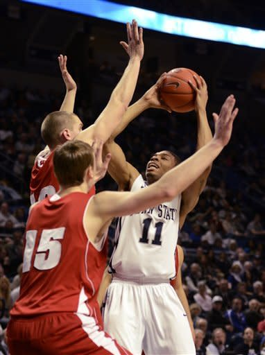 Penn State's Jermaine Marshall (11) shoots over the heads of moves around Wisconsin's Sam Dekker (15) and Jared Berggren during the first half of an NCAA college basketball game in State College, Pa., Sunday, March. 10, 2013. (AP Photo/Ralph Wilson)