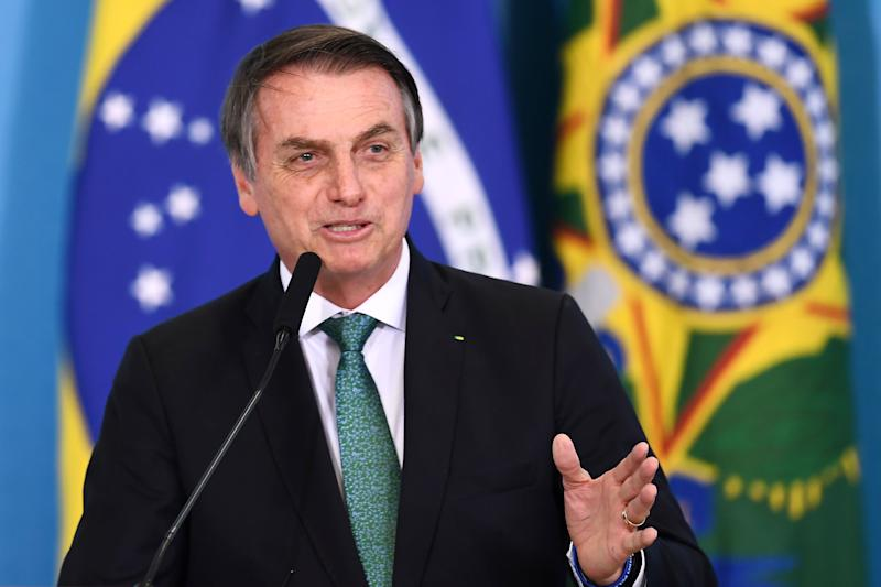 Brazilian President Jair Bolsonaro delivers a speech during a ceremony to announce measures to stimulate the economy at Planalto Palace in Brasilia, on July 24, 2019. - According to the government, the measures will be in force in September and they are planned to inject 42 billion reals (around 11 billion dollars) in the economy by 2020. (Photo by EVARISTO SA / AFP) (Photo credit should read EVARISTO SA/AFP via Getty Images)
