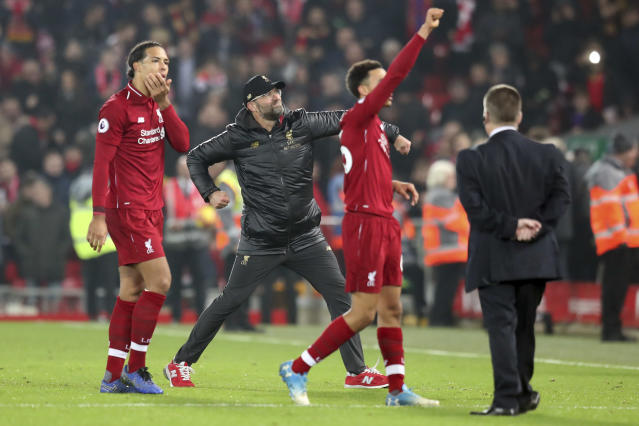Liverpool coach Juergen Klopp, center, celebrates at the end of the English Premier League soccer match between Liverpool and Newcastle at Anfield Stadium, in Liverpool, England, Wednesday, Dec. 26, 2018. (AP Photo/Jon Super)