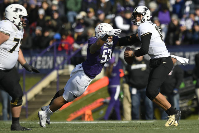 Northwestern defensive end Eku Leota (53) strips the ball away from Purdue quarterback Aidan O'Connell (16) causing a fumble during the first half of an NCAA college football game, Saturday, Nov. 9, 2019, in Evanston, Ill. (AP Photo/Paul Beaty)