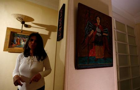 Ragaay is seen near a religious portrait at her home in the Cairo suburb of Maadi