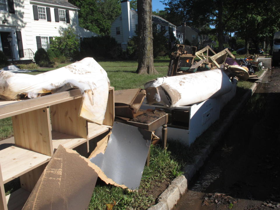 Flood-wrecked household debris sits on a curb in Cranford N.J. on Saturday Sept. 4, 2021, part of a massive cleanup in many areas of New Jersey from damage caused by the remnants of Tropical Storm Ida. (AP Photo/Wayne Parry)