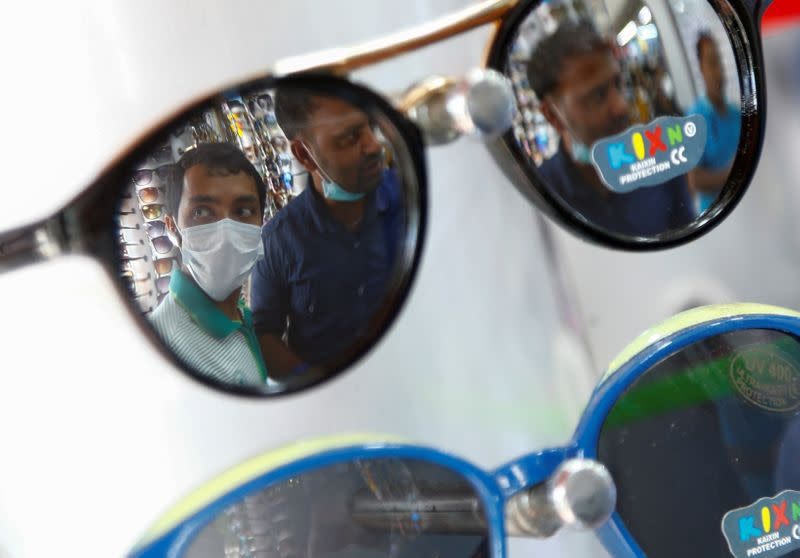 Migrant workers from Bangladesh shop for sunglasses in Singapore