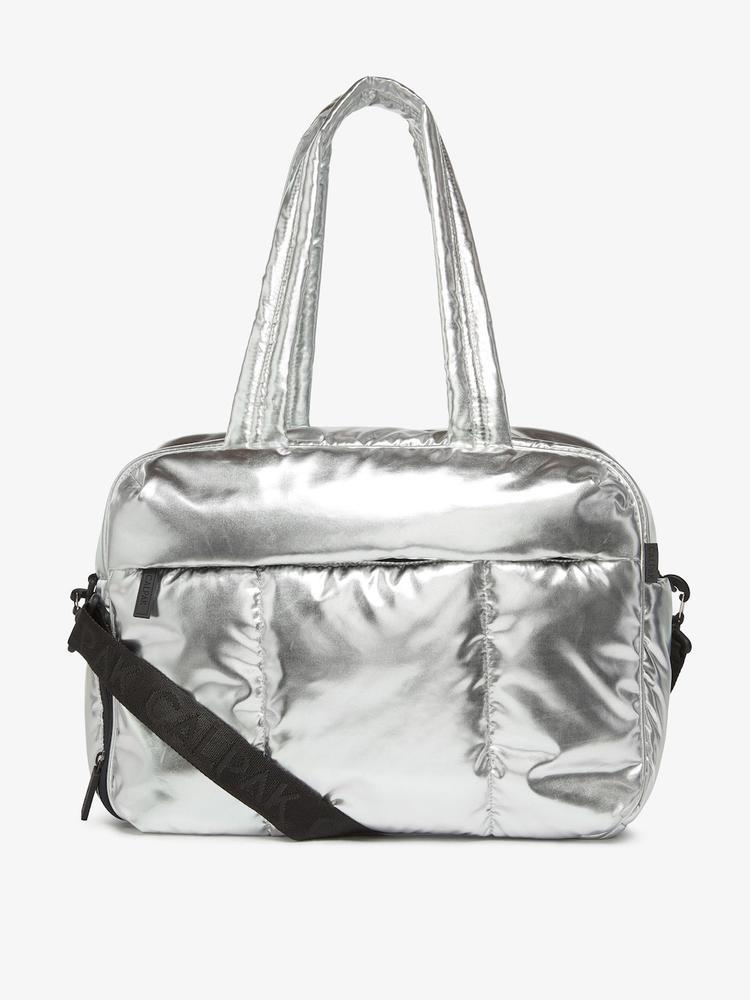 """<h2>Calpak Luka Duffel</h2><br>The new winner of our roundup that details the <a href=""""https://www.refinery29.com/en-us/best-weekender-bags-for-women"""" rel=""""nofollow noopener"""" target=""""_blank"""" data-ylk=""""slk:best weekender bags"""" class=""""link rapid-noclick-resp"""">best weekender bags</a> was this Calpak showstopper. The metallic silver duffel is crafted from a durable soft-shelled material in a multi-compartment design that packs enough storage space for a full change of clothes (shoes included!).<br><br><em>Shop <strong><a href=""""https://www.calpaktravel.com/products/luka-duffel/silver"""" rel=""""nofollow noopener"""" target=""""_blank"""" data-ylk=""""slk:Calpak"""" class=""""link rapid-noclick-resp"""">Calpak</a></strong></em><br><br><strong>Calpak</strong> Luka Duffel, $, available at <a href=""""https://go.skimresources.com/?id=30283X879131&url=https%3A%2F%2Fwww.calpaktravel.com%2Fproducts%2Fluka-duffel%2Fsilver"""" rel=""""nofollow noopener"""" target=""""_blank"""" data-ylk=""""slk:Calpak"""" class=""""link rapid-noclick-resp"""">Calpak</a>"""