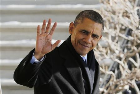 U.S. President Barack Obama waves before departing the White House in Washington
