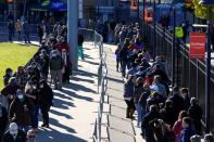Voters wait in line to cast their ballots during early voting at ONEOK Field in Tulsa