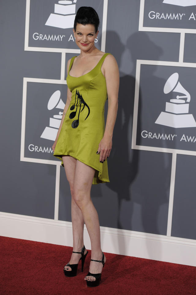 Pauley Perrette arrives at the 53rd annual Grammy Awards on Sunday, Feb. 13, 2011, in Los Angeles. (AP Photo/Chris Pizzello)