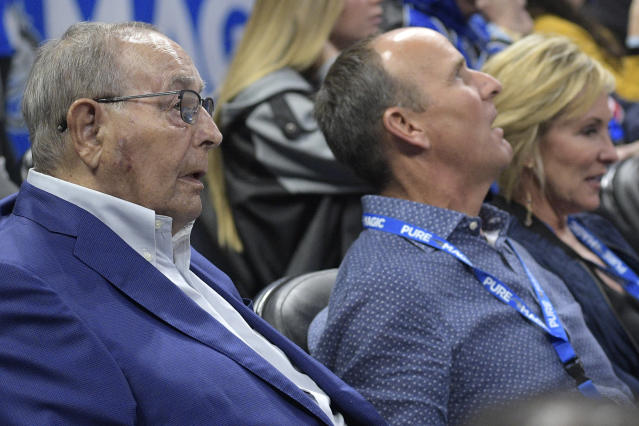 "Rich DeVos (left) and his son, Doug, sit courtside at an <a class=""link rapid-noclick-resp"" href=""/nba/teams/orl"" data-ylk=""slk:Orlando Magic"">Orlando Magic</a> game in January. (AP)"