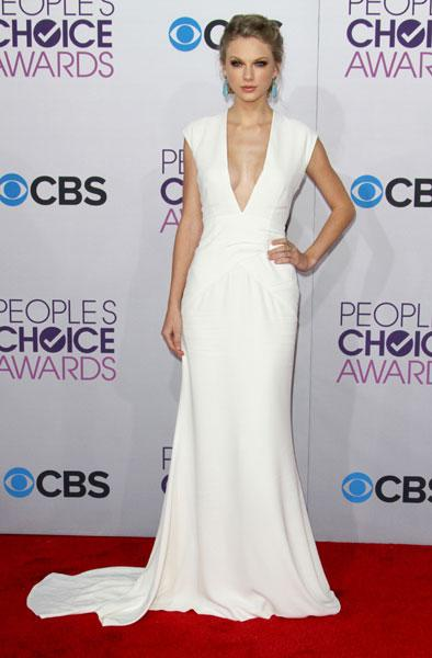 "<b>Taylor Swift </b><br><br>The Trouble singer showed ex Harry Styles what he's missing in a white v-neck Ralph Lauren gown at the <a target=""_blank"" href=""http://uk.lifestyle.yahoo.com/photos/people-s-choice-awards-2012-best-and-worst-dressed-stars-slideshow/"">People's Choice Awards</a>.<br><br>Image © Rex"