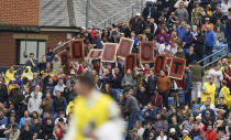 England supporters display placards as England captain Joe Root comes into bat during the second day of third test cricket match between England and India, at Headingley cricket ground in Leeds, England, Thursday, Aug. 26, 2021. (AP Photo/Jon Super)