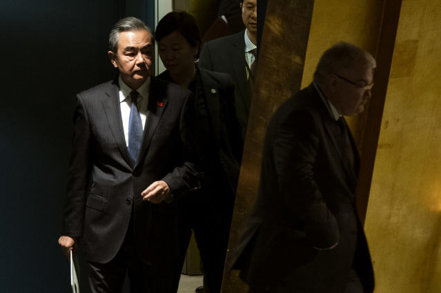 Chinese Foreign Minister Wang Yi approaches the podium before addressing the 74th session of the United Nations General Assembly, Friday, Sept. 27, 2019, at the United Nations headquarters. (AP Photo/Craig Ruttle)